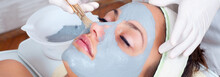 Girl With Facial Mask Lying In Beauty Health Spa Center