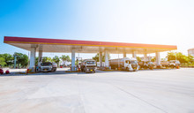 Gas Station With Oil Tank Trucks At Sunrise