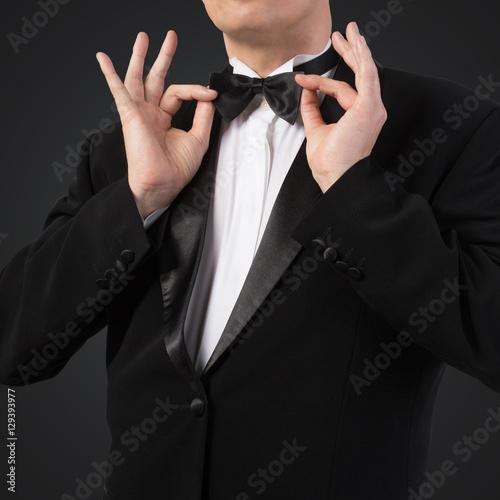 фотография  Sexy man in tuxedo and bow tie posing