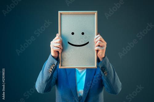 Carta da parati  Businesswoman is optimistic, holding smiley emoticon over face