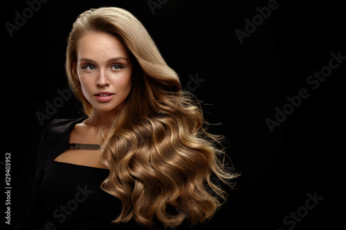 Beautiful Long Hair. Woman Model With Blonde Curly Hair