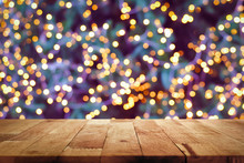 Wood Table Top With Bokeh From Decorative Light On Christmas Tree