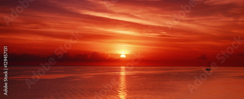 Aluminium Prints Brick Beautiful colorful sunrise at the sea with dramatic clouds and sun shining