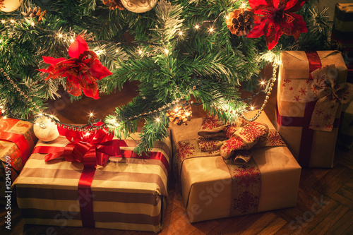 фотографія  Christmas gifts in front of Christmas tree