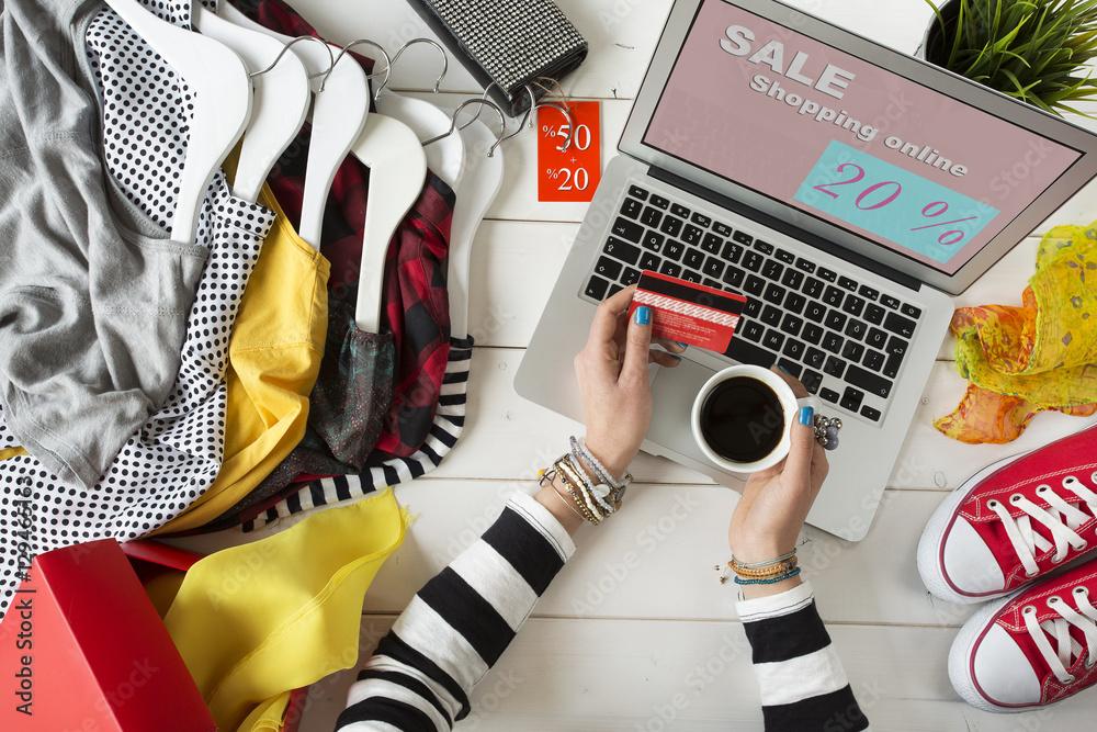 Fototapeta Woman shopping on internet