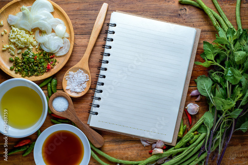 Recipe book with fresh herbs and spices on wooden background thai recipe book with fresh herbs and spices on wooden background thai food forumfinder Choice Image