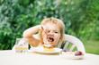 Baby boy eats dessert