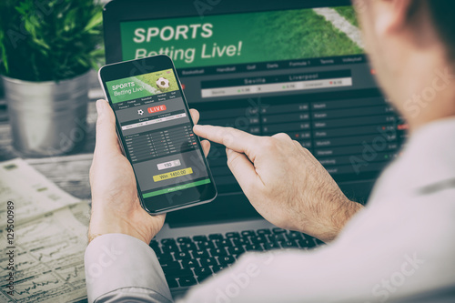 Canvas Print betting bet sport phone gamble laptop concept