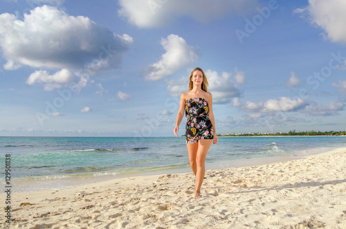 Poster Girl walking at the beach