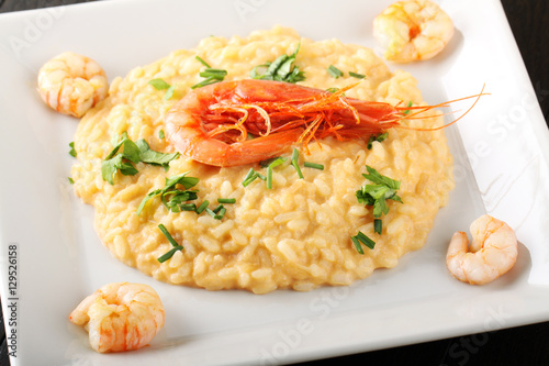 Fotografering  Risotto with scampi sauce