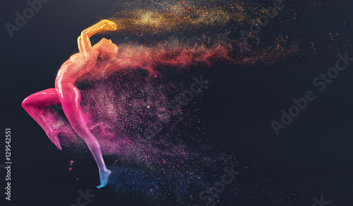 Photo  Abstract colorful plastic human body mannequin figure with scattering particles over black background