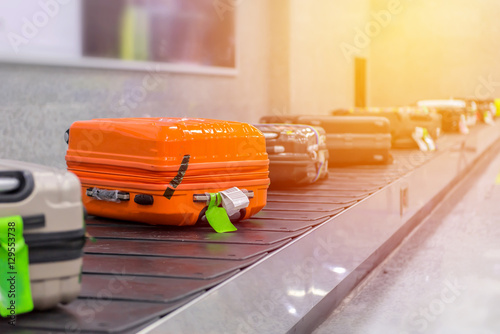 Fotografie, Obraz  Suitcase or luggage with conveyor belt in the airport