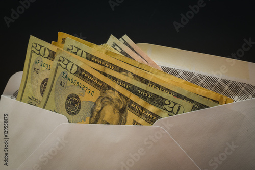 Fotografie, Obraz  Dollars in white security envelope