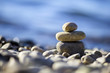 Zen balancing pebbles on the beach