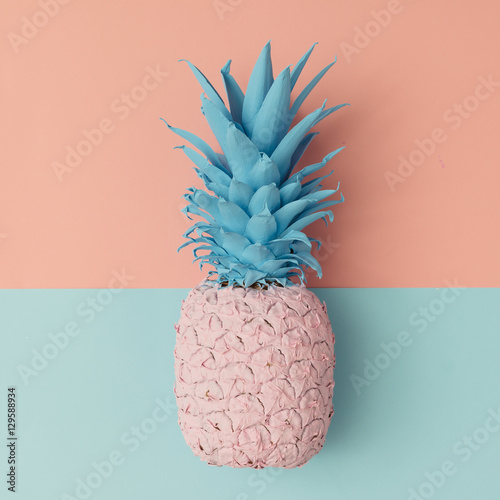 Fotografie, Obraz  Pink pineapple on pink and blue pastel background. Minimal style
