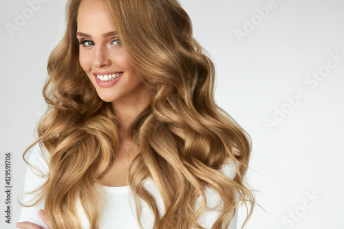Vászonkép Beautiful Curly Hair. Girl With Wavy Long Hair Portrait. Volume