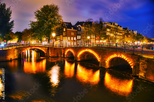 Photo  Amsterdam city view with canals and bridges