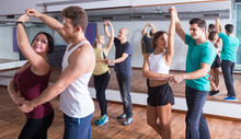 Girls And Men Learning Salsa