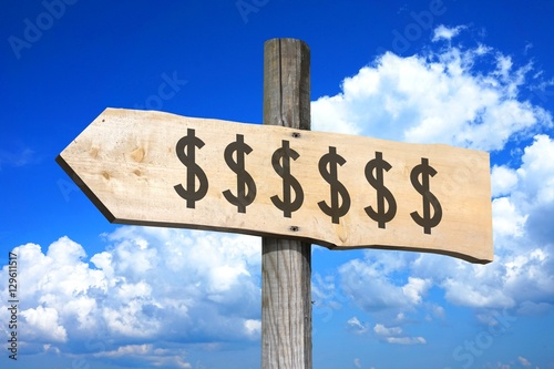 Dollar signs - wooden signpost - Buy this stock photo and