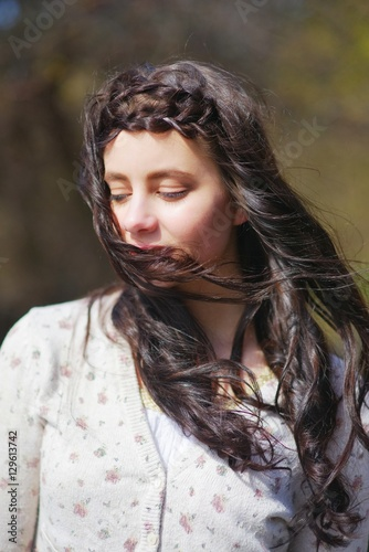 Fotografia  Portrait is incredibly beautiful long haired brunette girl, with drooping lashes