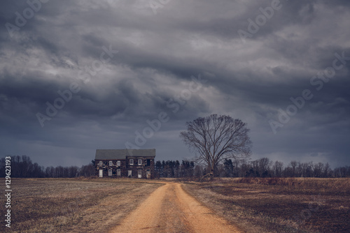 Omnious clouds over abandoned house Canvas Print