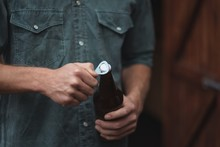 Man Opening A Beer Bottle