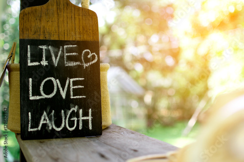 """Close up label """"LIVE LOVE LAUGH""""on coffee shop. Poster"""