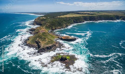 Fotografie, Obraz  Aerial panorama of Cape Schanck coastline, lighthouse, and Pulpit Rock