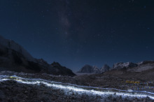 Departure Of The Sherpas, Their Head-torches Leaving Trails Of Light Across The Glacier On Their Way To Everest, Nepal, Himalayas