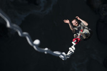 A Man Smiles For The Camera As He Is Bounced Back Up During A Bungee Jump At The Last Resort, Nepal