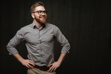 Man In Eyeglasses Standing With Hands On Hips