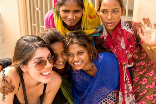 Photo  Tourist taking photos with cute Indian girls