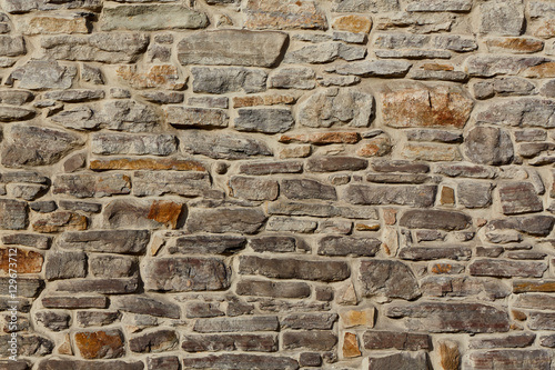Stone wall rustic texture background..