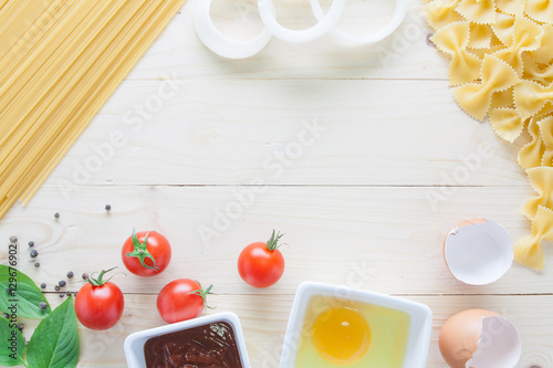 Stampe  spaghetti with ingredients for cooking on wood