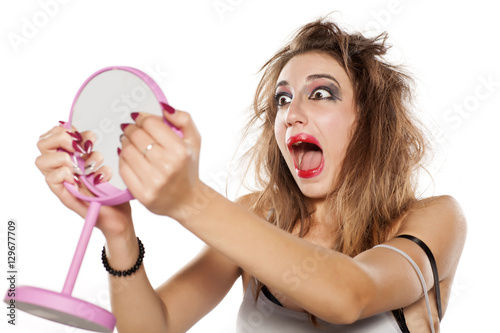 Shocked Young Woman With Bad Makeup And Messy Hair Looking At