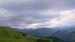 Fantastic Mountain Landscape with Dark Clouds at Sunset. Timelapse. 4K.
