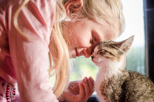 Happy Blond Girl With Cat