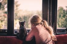 Child Hugging A Cat