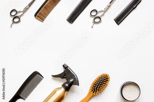 Fotografie, Obraz  combs and hairdresser tools on white background top view