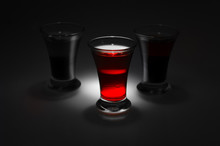 Red And Tow Shot Glass On A Da...