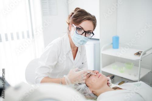 Fotografie, Obraz  Woman cosmetologist at work