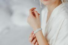 The Bride Wears A Bracelet On Hand