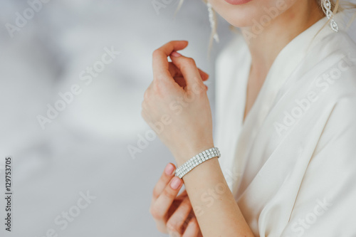 the bride wears a bracelet on hand Fototapeta