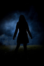 Spooky Silhouette Girl At Night With Smoke In Background