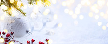 Bright Christmas; Holidays Background With Xmas Ornament On Snow