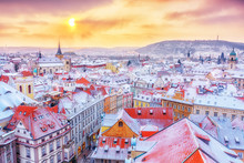 Prague In Christmas Time, Classical View On Snowy Roofs In Central Part Of City.