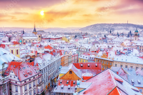 Poster Prague Prague in Christmas time, classical view on snowy roofs in central part of city.