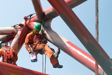 Workers Working At Height To Paint The Jack Up Oil And Gas Rig