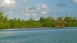 View from sailing boat to the wooden pier with arbor and green bushes