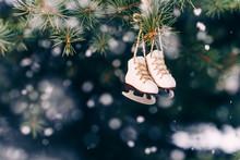 Closeup Christmas Tree Decoration Small Ice Skates On The Snowfall Background